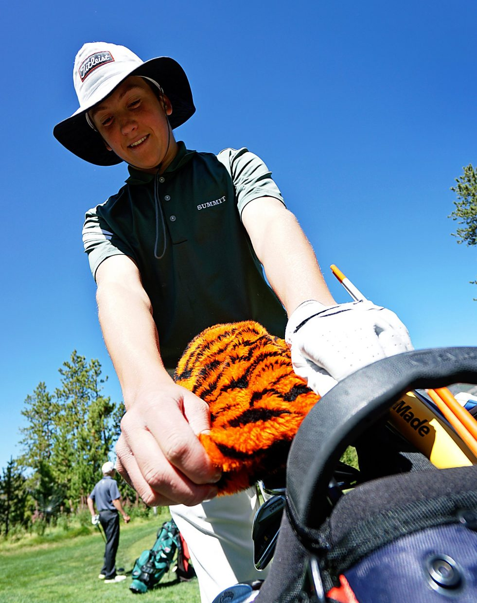 Summit High School's Graham Gaspard places a tiger headcover on his driver after teeing off on the first hole at the Keystone Ranch Invitational in 2015. The tournament returns to the Keystone golf club on Sept. 8.