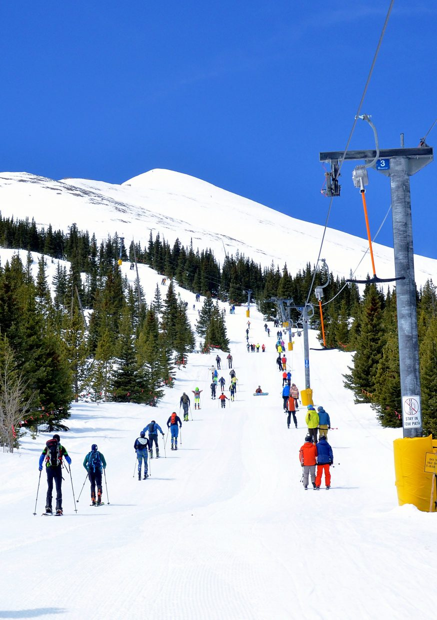 Competitors in the 2016 Imperial Challenge skin parallel to skiers on the T-Bar at Breckenridge on April 22. Downhill skiing is a good workout, especially in powder, but cross-country and uphill travel blows it away and burn up to 1,161 calories/hour.
