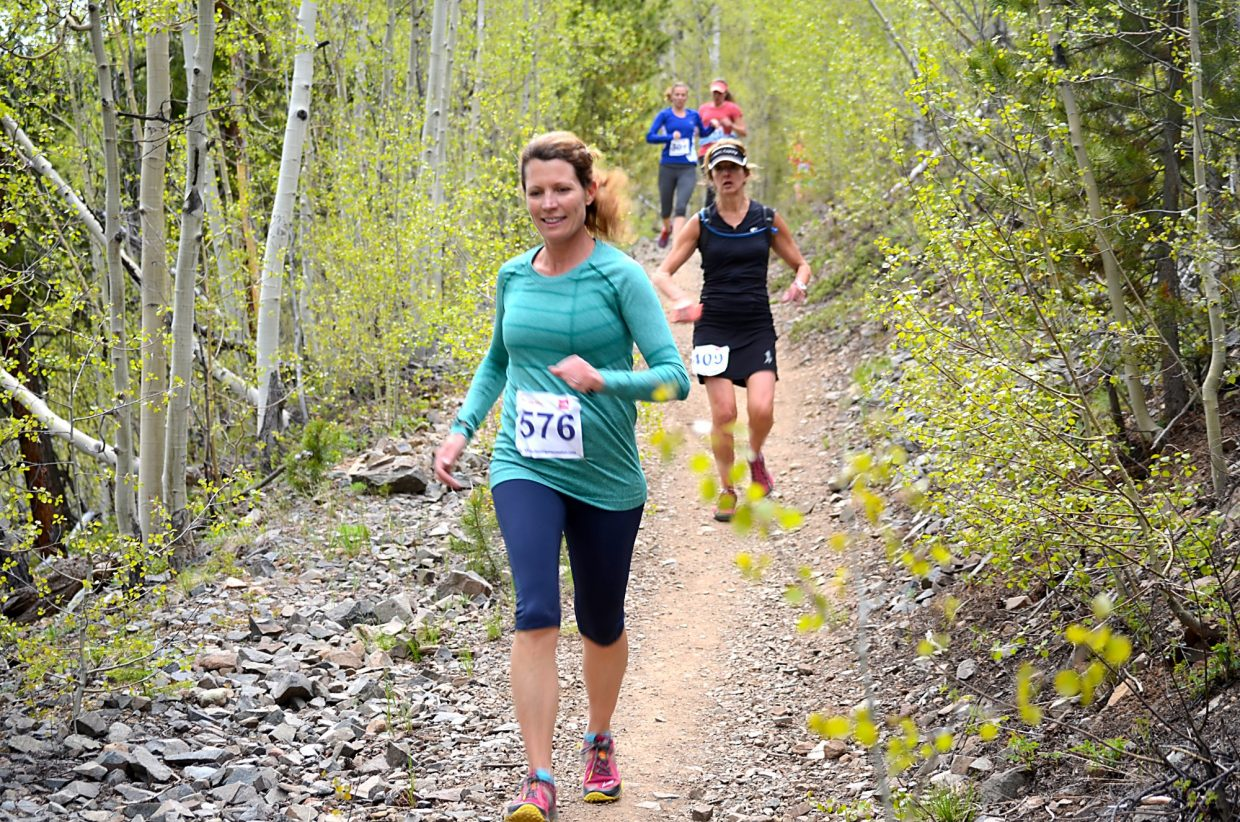 On the trail again: Runners tackle the long (6K) and short (4K) courses at the French Gulch trail run during the Summit Trail Running Series last season. On average, trail running burns 633+ calories/hour and up to 1,056 on uphill routes like we have in Summit County.