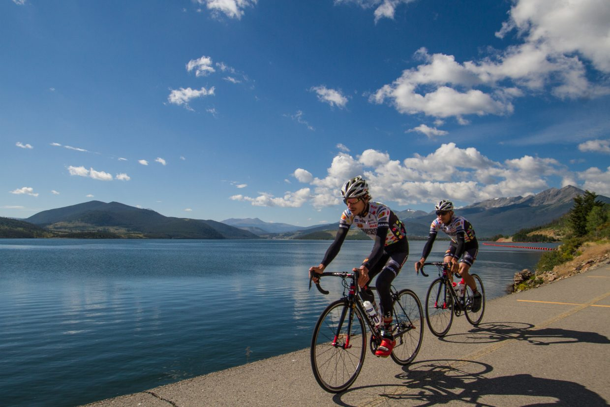 Brothers Lachlan (front) and Angus Morton of Jelly Belly-Maxxis bike past Lake Dillon on a high-altitude training ride the before the2015  USA Pro Challenge. The new 106 West Triathlon on Sept. 10 takes athletes on a 56-mile bike course from the Dillon Marina to Montezuma Road and back.