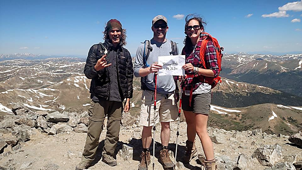 The author (right) and friends at the summit of Torreys Peak (14,275 feet) after two failed attempts to reach the 14er and its nearby sister, Grays Peak (14,278 feet).
