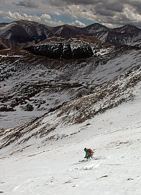 The author makes turns at Jones Pass in October 2013. Colorado snowpack is notoriously difficult to predict, and snowfall early in autumn can be a tricky indicator for the season to come.