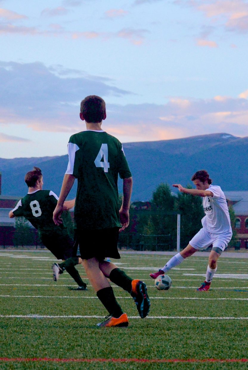 Summit senior midfielder Cole Catron battles for the ball in the second half of a home soccer game against Conifer on Sept. 1. The Tigers won, 2-0.