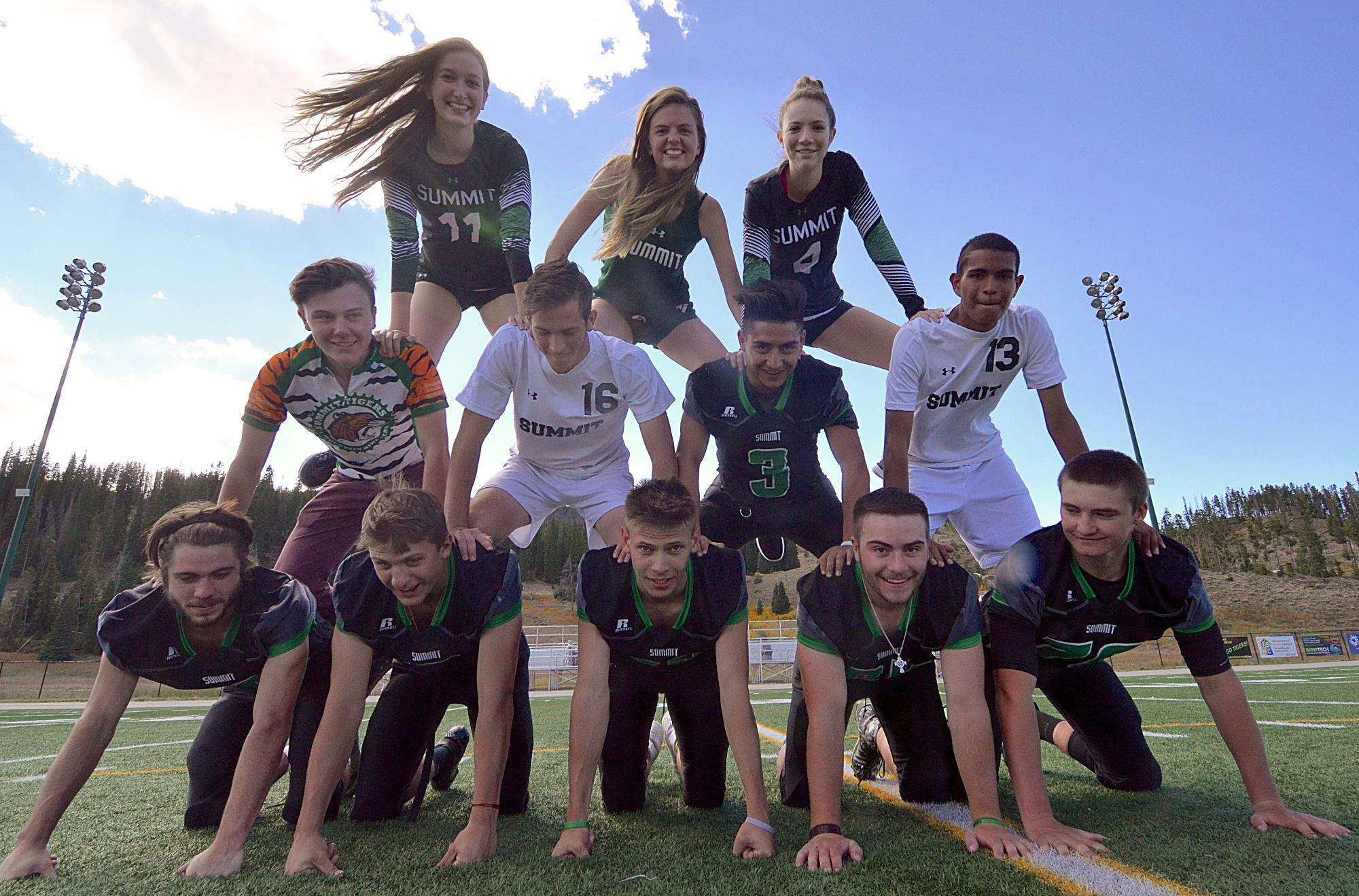 Summit High School's senior athletes and all-stars test their balance in a pyramid. Bottom row, left to right: Matthew Francomano (football No. 10), Sam Hull (football No. 7), Eric Robinson (football No. 89), Harmon Daugherty (football No. 64), Dean Vangsnes (football No. 78).Middle row, left to right: Spencer Tyson (MTB), Cole Catron (soccer No. 16), Adolfo Vasquez (football No. 3), Carlos Martinez (soccer No. 13).Top row, left to right: Elle Lyne-Schiffer (volleyball No. 11), Katie Mason (XC), Jemma Jackman (volleyball No. 4).