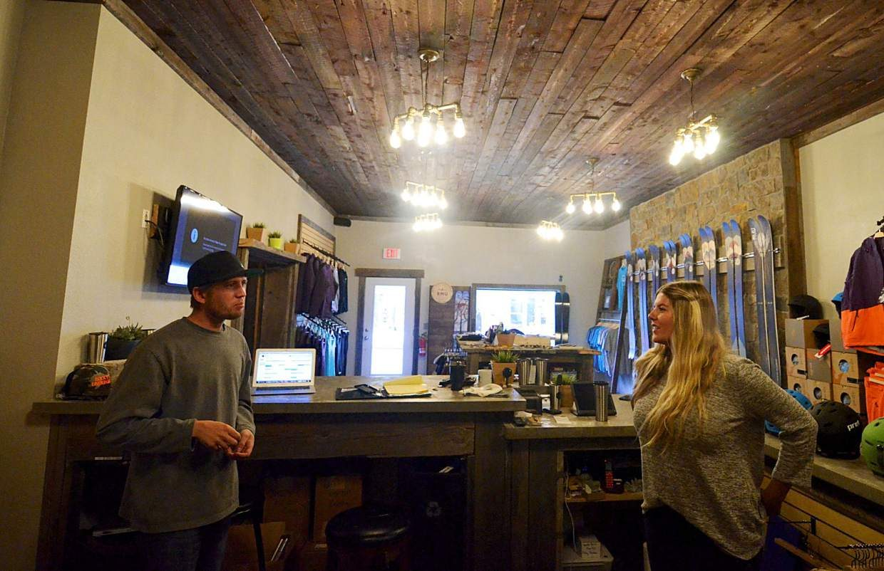 Rocky Mountain Underground co-founder Mike Waesche (left) and new marketing manager Jessie Unruh talk inside the company's new showroom on Main Street in Breckenride. The 1,000-square-foot retail space is attached to a 700-square-foot bar, making it the first combination ski shop/bar in town.