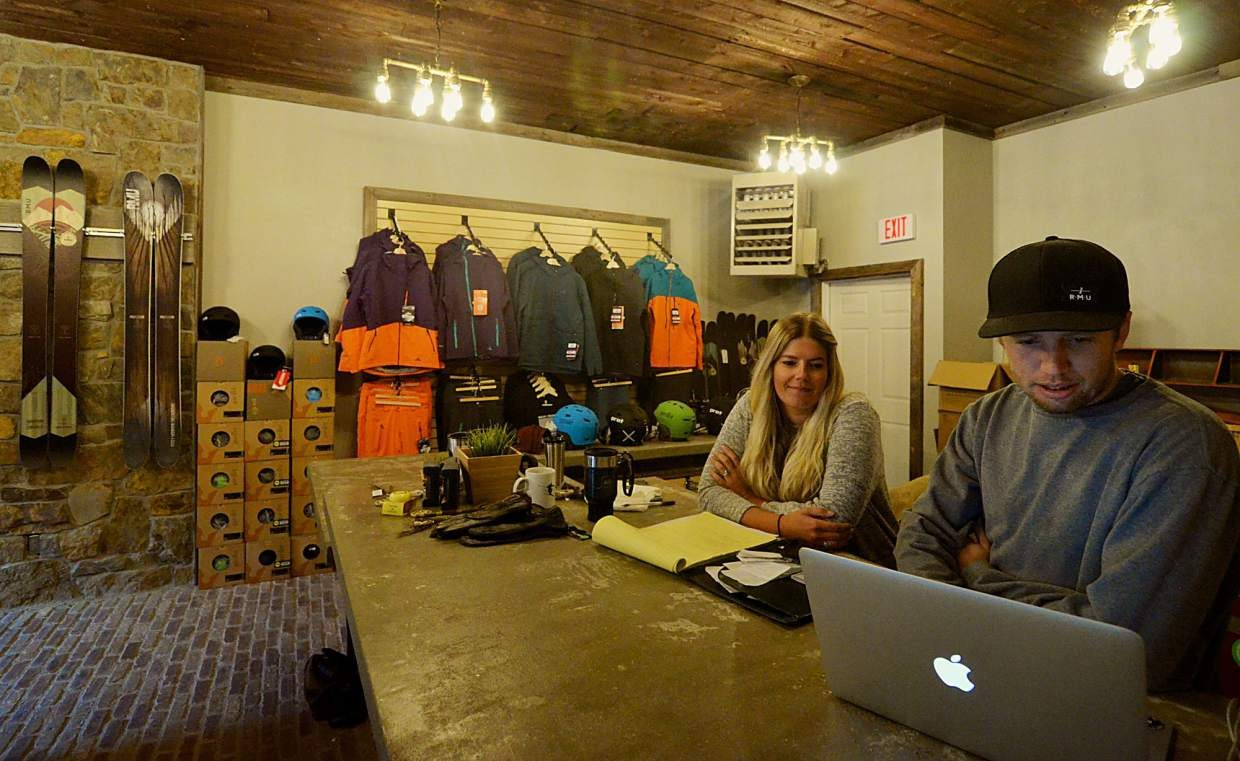 Rocky Mountain Underground co-founder Mike Waesche (right) and new marketing manager Jessie Unruh behind the retail desk inside of RMU's new showroom on Main Street. The location also includes a bar, making it the first combination ski shop/bar in Summit County.