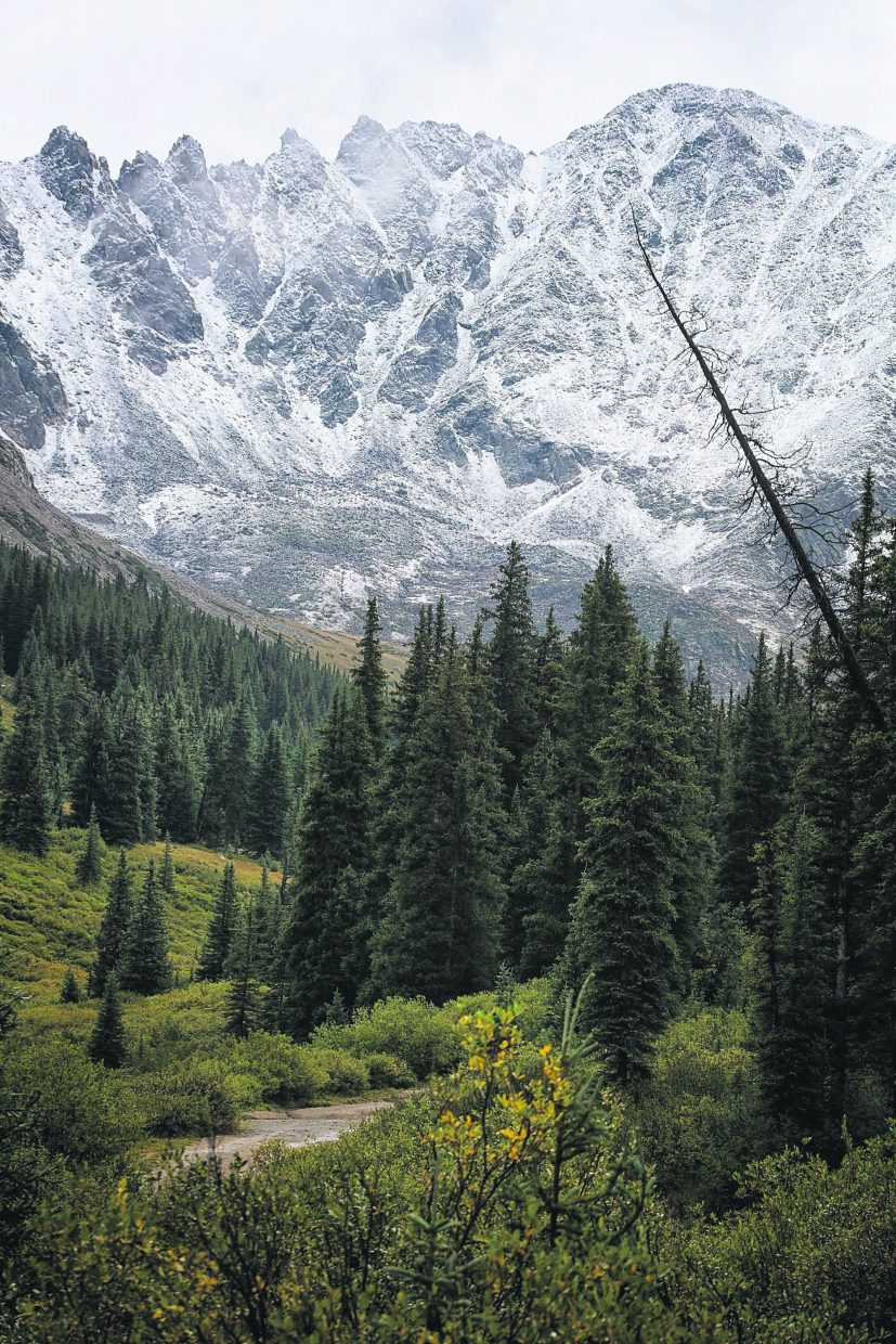 A dusting of snow covers peaks on the south edge of Summit County during the first snowfall of the season on Aug. 24.
