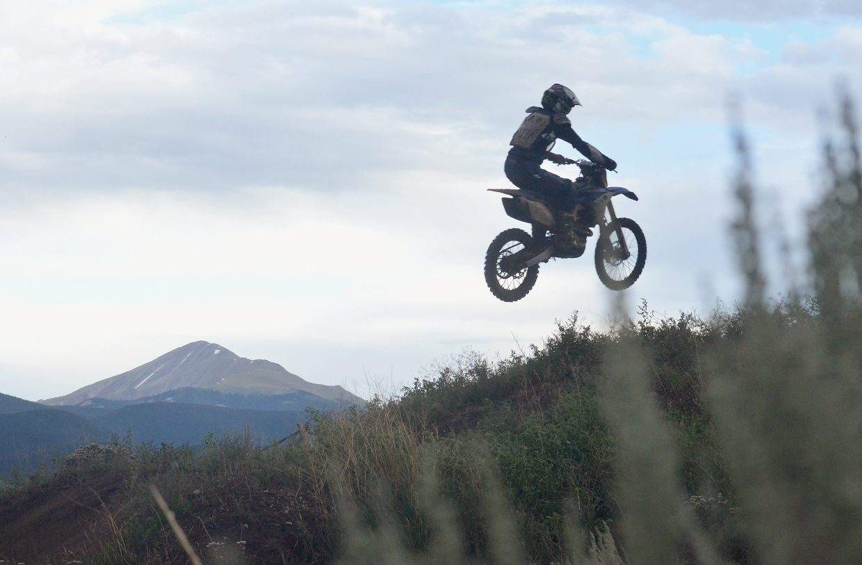 Local moto rider Mike Weaver on the step-up jump, one of 18 hand-built jumps at the Tenderfoot MX track outside of Dillon. The track is home to jumps, berms and rollers on 1.5 miles of trail.