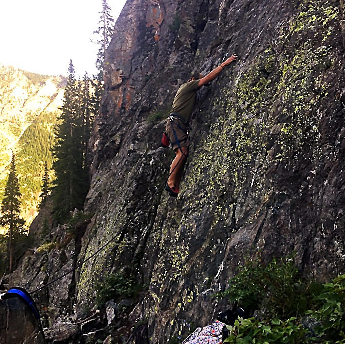 Sage Miller leading the way up a 5.8 route at Officer's Gulch West, titled Logan's Run. The Hidden Wall area of Officers Gulch West has sport routes from 5.5 to 5.11.