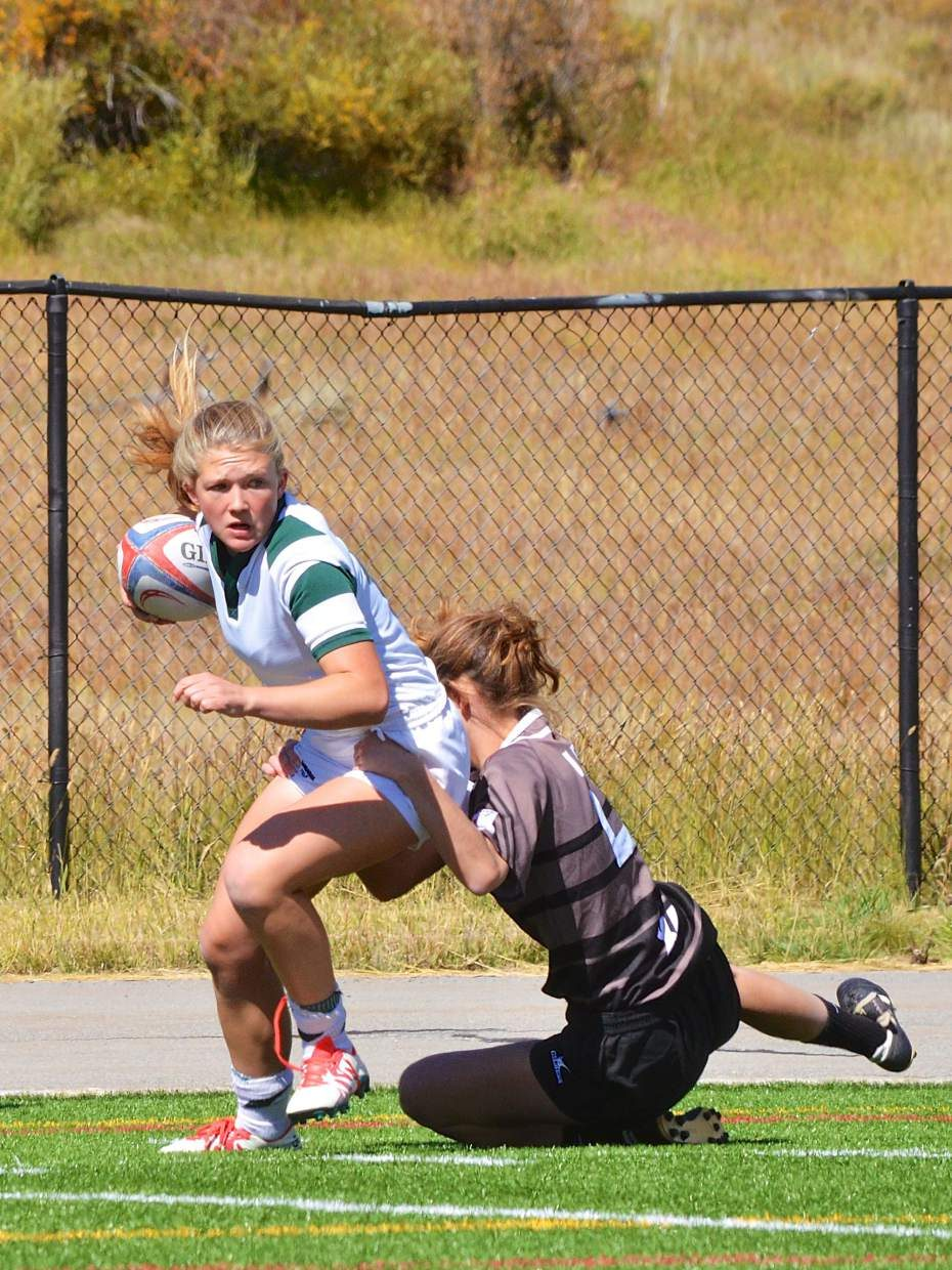 Summit Rugby's Delanie Bargell, younger sister of All-American Cassidy Bargell, slips away from a tackle during a recent match against Palmer of Colorado Springs. The younger Bargell is following in her sister's footsteps with fast-break offensive moves and plenty of energy.