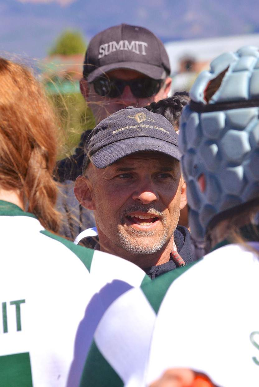 Summit Rugby founder and head coach Karl Barth talks with his team between halves at a recent sevens match at home. Barth launched the team as a club in 1997, and since becoming a varsity club sport in 2006, he's led the team to eight consecutive state championships and multiple appearances at high school national championships.