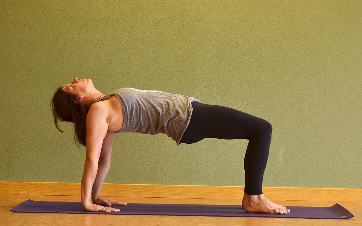 Half upward-facing plank yoga posture for rock climbers.