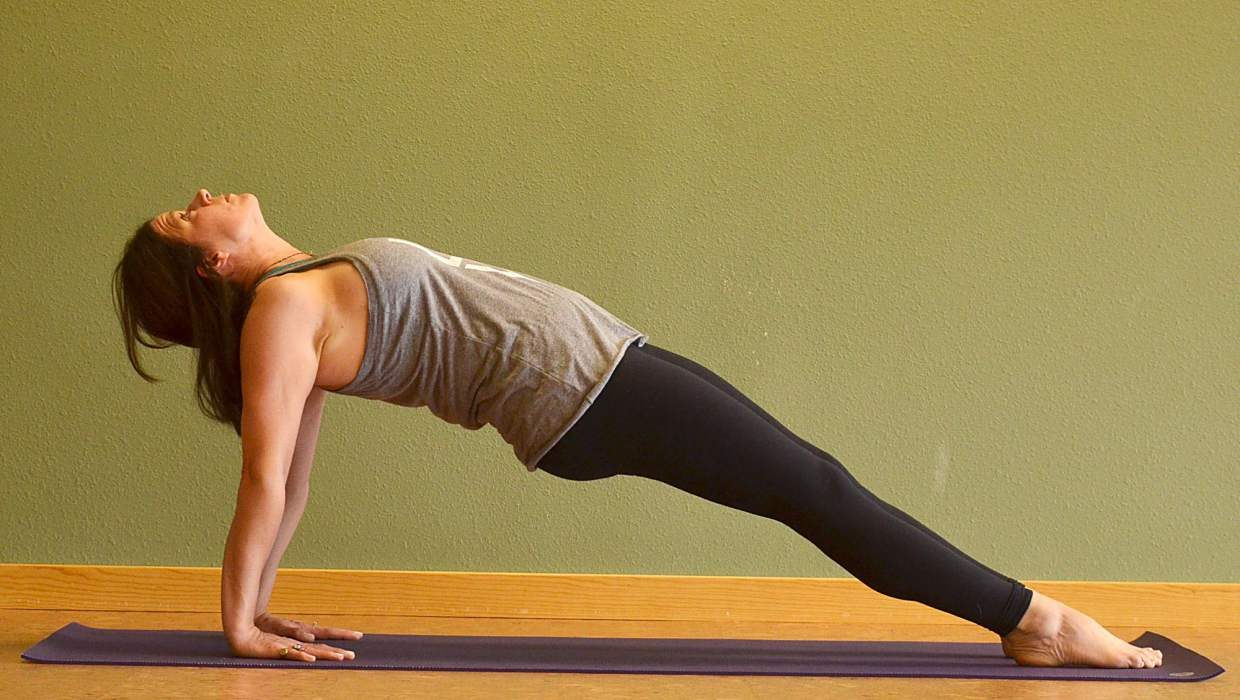 Upward-facing plank yoga posture for rock climbers.