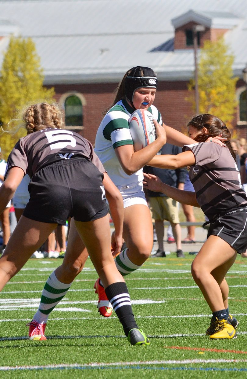 Scenes from the Summit girls rugby game against Palmer on Sept. 17. The Tigers won, 71-0.