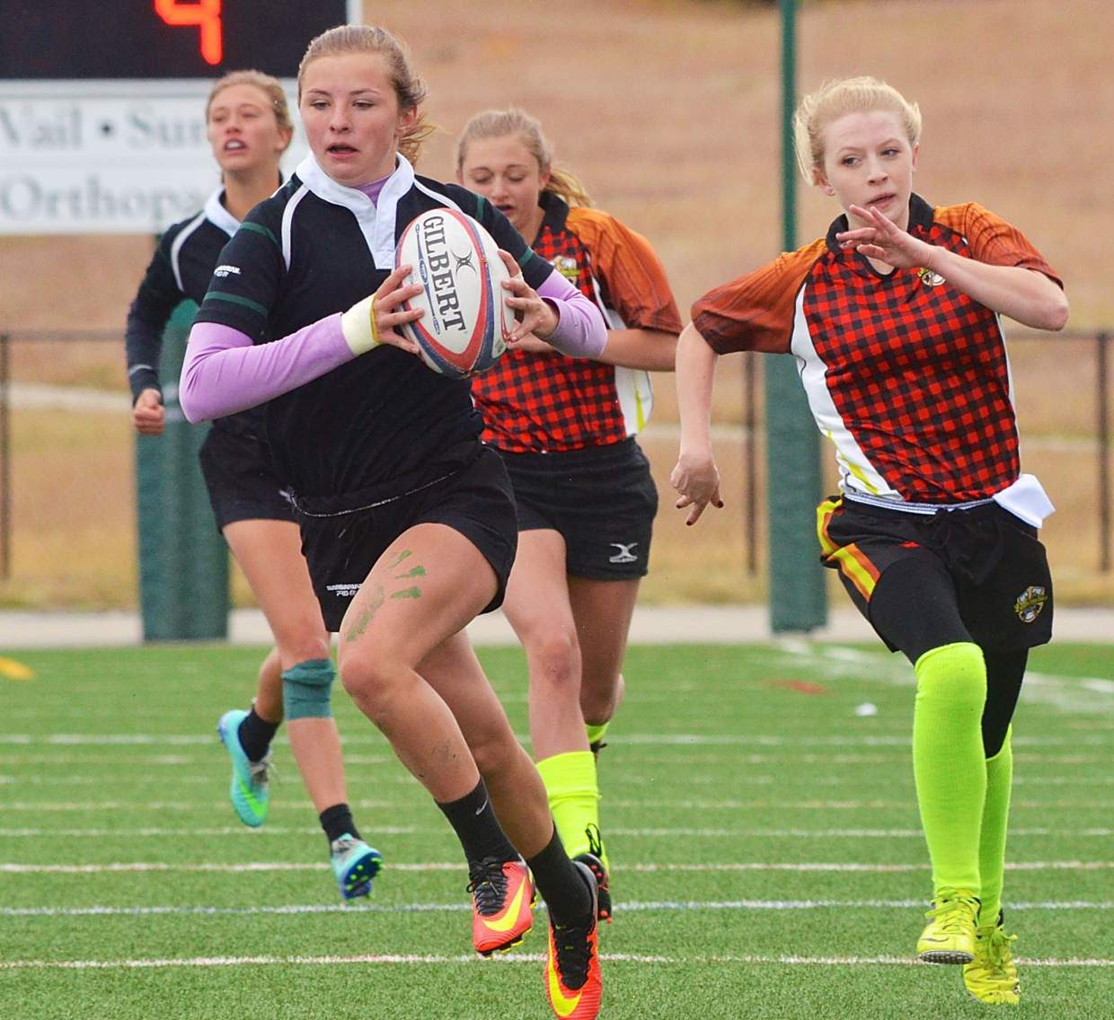 A Summit Black player streaks downfield with Lumberjackies players in hot pursuit during a round of pool play at the Tigers homecoming sevens rugby tournament on Sept. 24. The Summit Black team beat Chaparral, 33-7, in the final to win the tourney.
