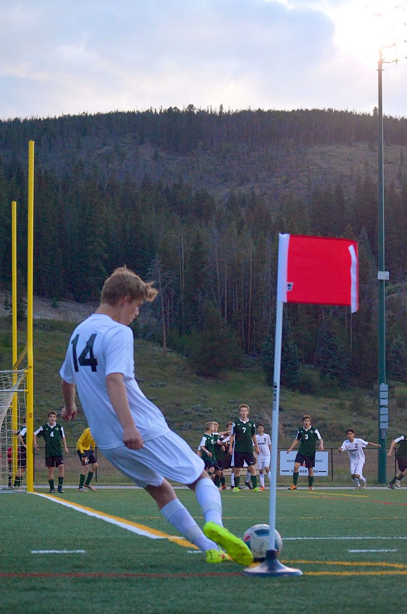 Summit junior Jackson Stone takes a corner kick against Conifer in the second half of a boy's soccer game at Tigers Field on Sept. 1. The Tigers won, 2-0.