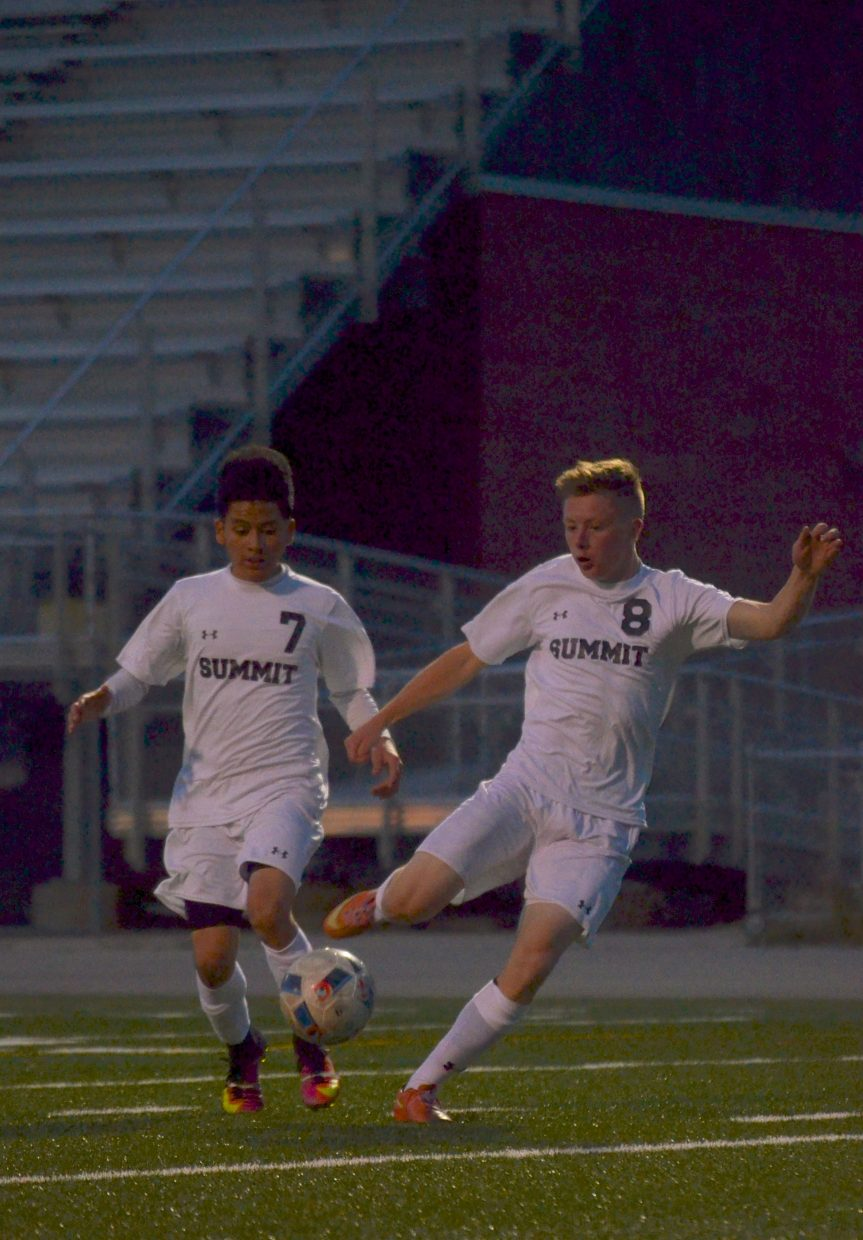 Summit forwards Gerson Martinez (left) and Conor Craig tag-team for a chance on the goal in the second half of a home soccer game against Conifer on Sept. 1. The Tigers won, 2-0.