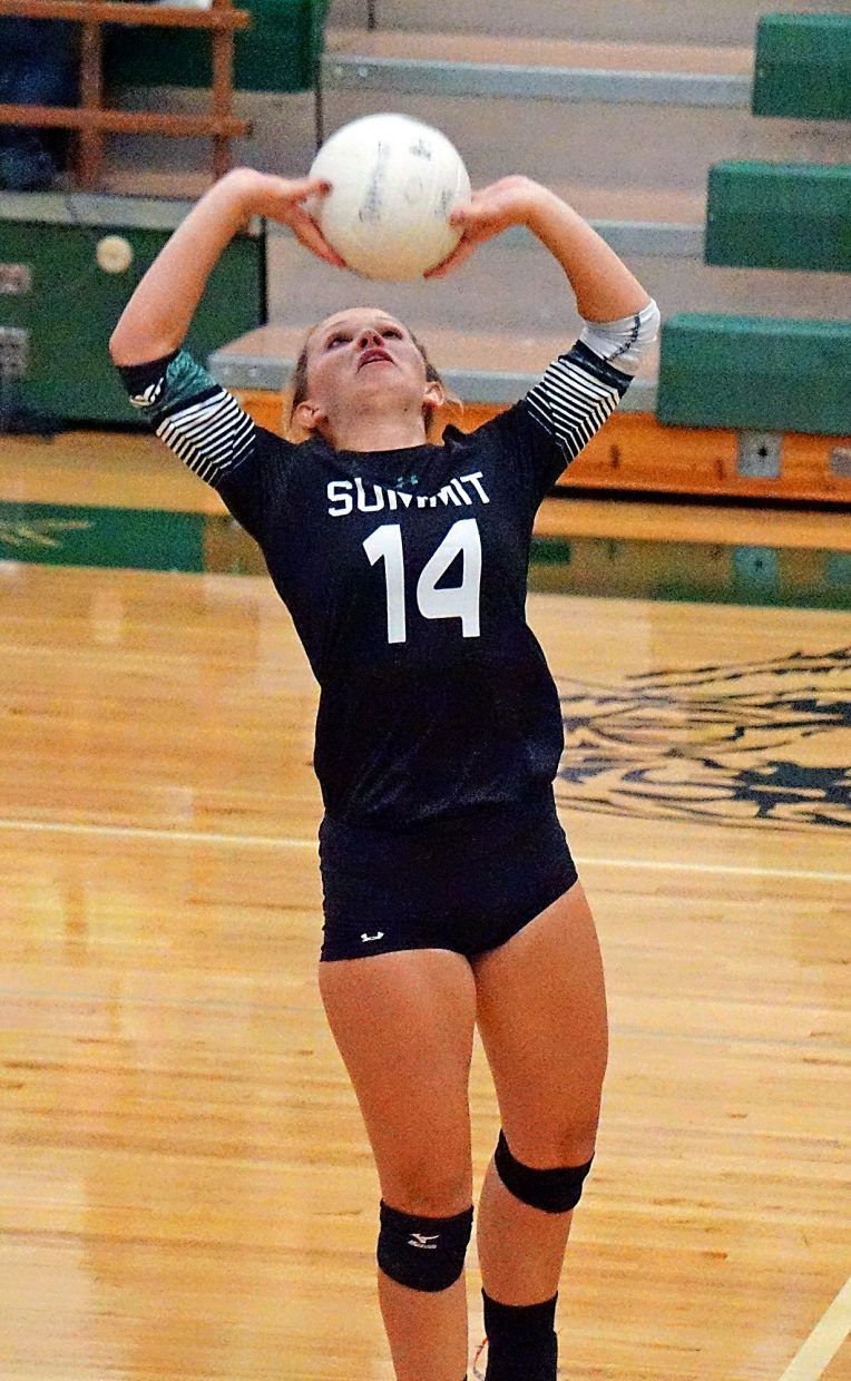 Summit's Anna Mathis (14) sets the ball during the Tigers 3-0 win over Rifle on Sept. 6.