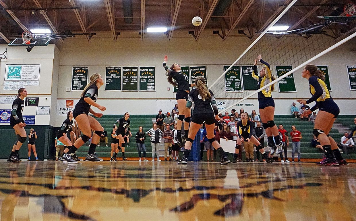 Summit's Elle Lyne-Schiffer jumps up to spike the ball during the Tigers 3-0 win over Rifle on Sept. 6.