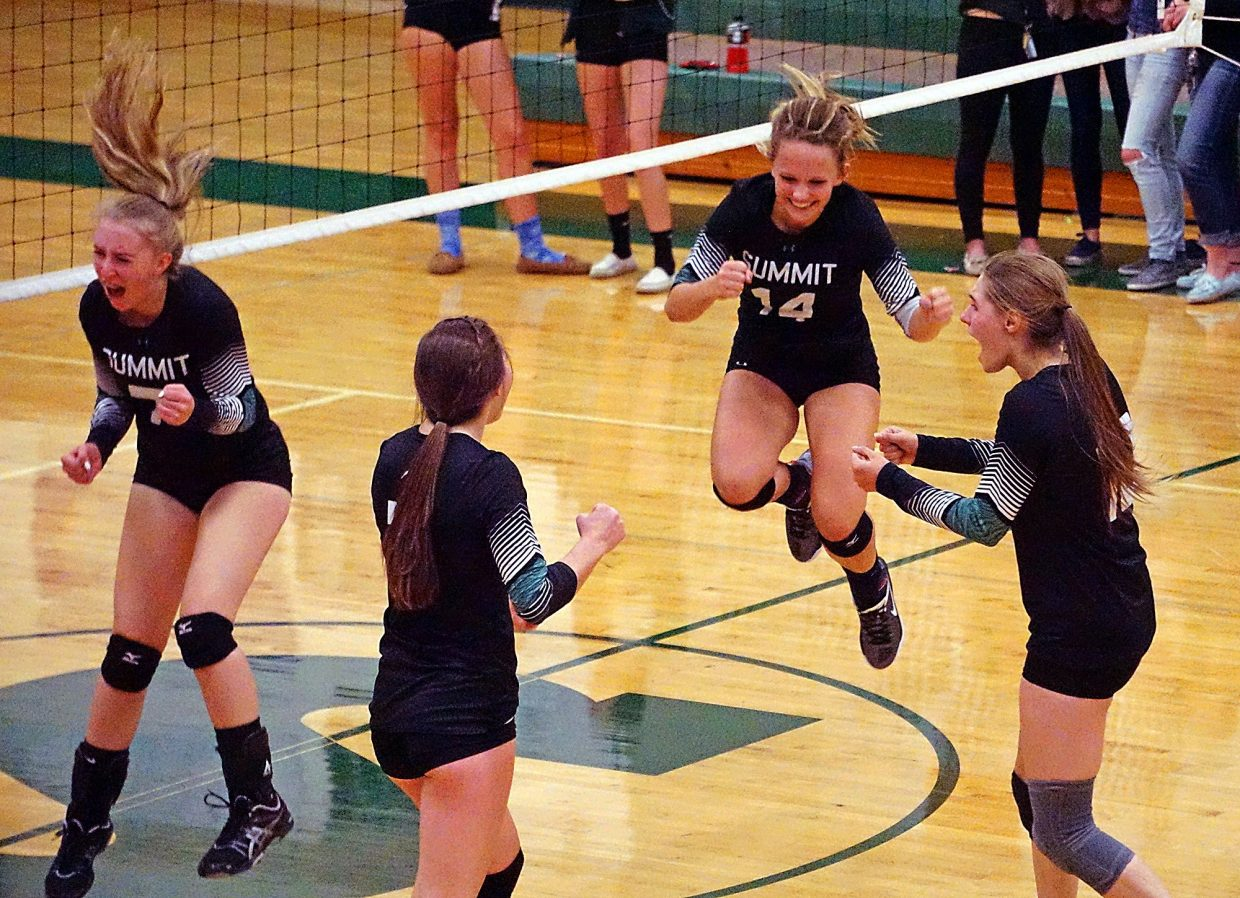 The Summit High girl's volleyball team celebrates their 3-0 win over Rifle on Sept. 6. The team is now 2-0 for the season on the strength and relies on a well-balanced team of sophomores, juniors and just three seniors.