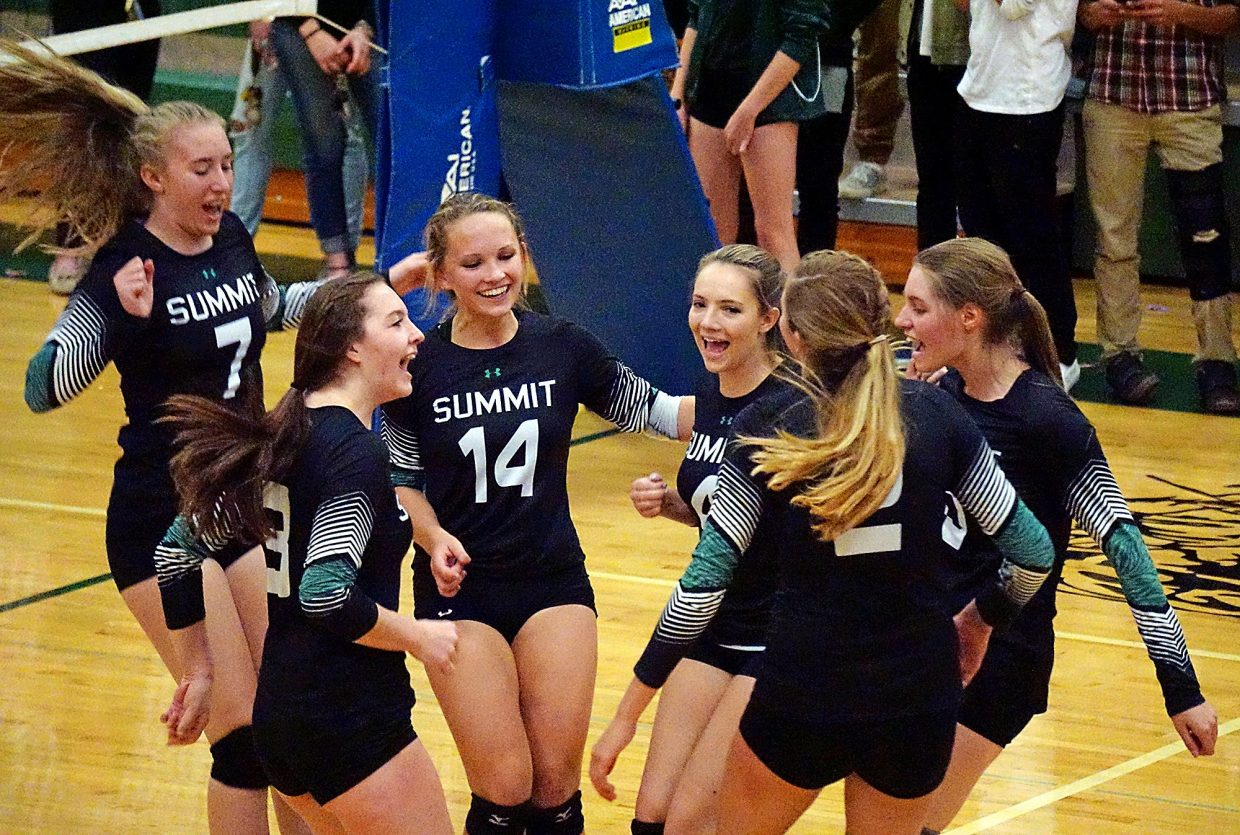 Summit girl's volleyball celebrates after winning a point during their 3-0 victory over Rifle on Sept. 6. The team is now 2-0 for the season on the strength and relies on a well-balanced team of sophomores, juniors and just three seniors.