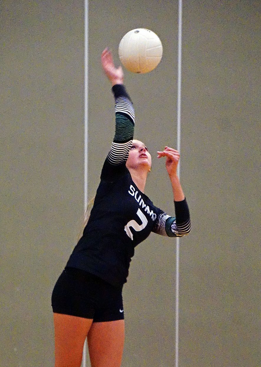 Summit's AnnaMarie Dodson serves the ball during the Tigers' 3-0 win over Rifle on Sept. 6.