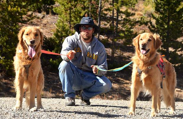 Copper ski patroller Chris Gray with his dog, 2-year-old golden retreiver Mason (left), and 5-year-old golden Rio. Gray has owned Mason since he was a puppy and selected him just for avy work.