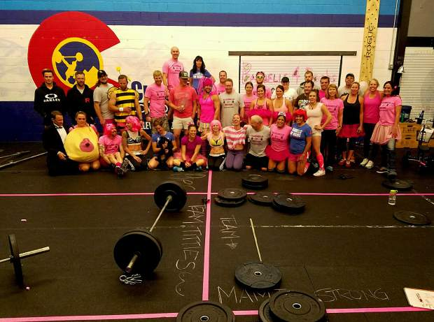 The pink-and-frilly crew at Crossfit Low Oxygen after everyone lifted 10,000 combined pounds each during the annual Barbells For Boobs fundraiser. The gym has currently raised $8,100 of the $10,000 goal for breast cancer screenings and other treatments.