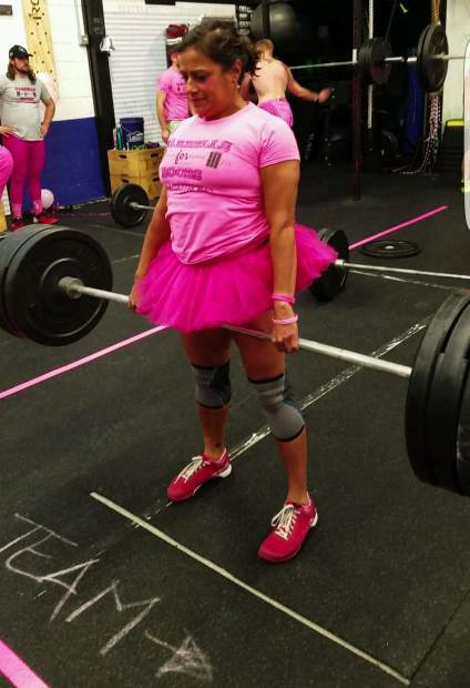 Mamta Shah during the deadlift portion of the Barbells For Boobs fundraiser at her local gym, Crossfit Low Oxygen in Frisco, on Oct. 25. The gym owners dedicated the annual event to Shah this year after the Summit Cove resident was diagnosed with breast cancer earlier this summer.