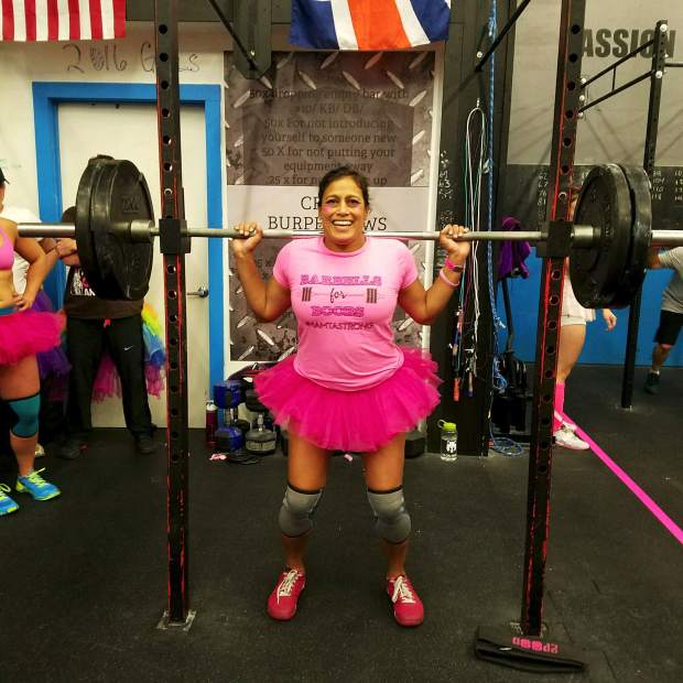 Summit Cove local Mamta Shah in the squat rack at Crossfit Low Oxygen in Frisco for the annual Barbells For Boobs fundraiser on Oct. 25. Shah was recently diagnosed with breast cancer, and so the gym owners dedicated this year's event to her.