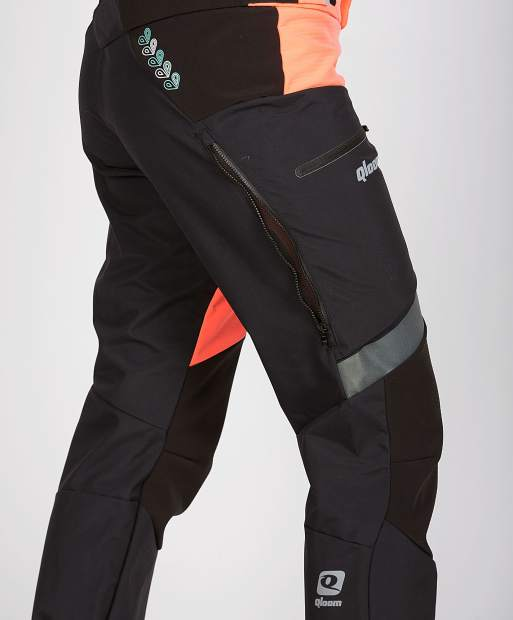The women's Qloom Cayley pants feature a higher cut for riding and are waterproof.