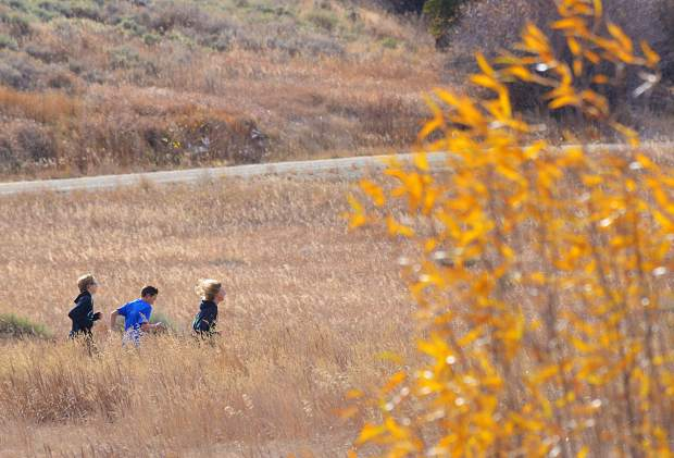A trio of Summit High cross-country runners led by freshman Max Bonenberger weaves through drying grass in a field near the high school on Oct. 19. The young team travels to 4A XC Regionals today at Connected Lakes State Park outside of Fruita.