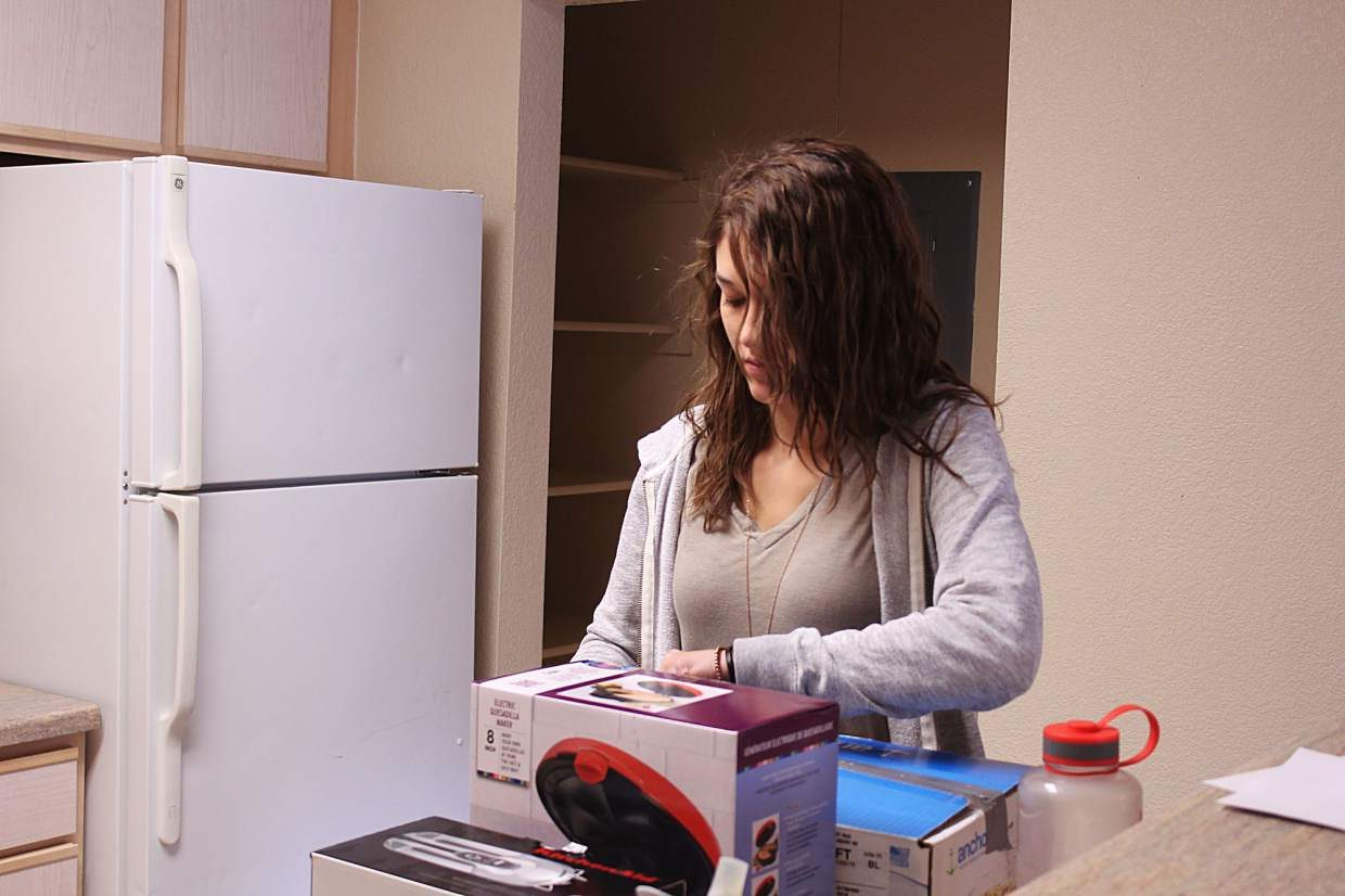 After moving into an apartment at Breckenridge Terrace on Oct. 5, a resident begins to unpack her things.