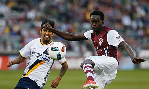 Colorado Rapids forward Dominique Badji, front, kicks the ball as Los Angeles Galaxy defender A. J. DeLaGarza defends in the first half of a MLS soccer game on March 12 in Commerce City. The Rapids face the Galaxy today en route to their first MLS Cup bid since 2010.