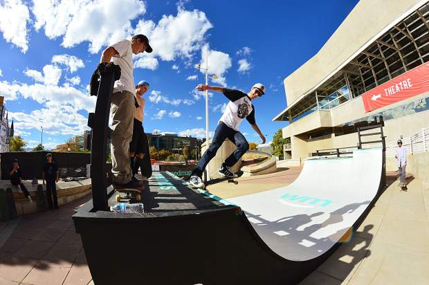 A skateboarder plays around on the ramp at 2016 Snowboard on the Block Festival in downtown Denver. The annual pre-season festival drew hundreds of spectators for film premieres, a gear village and on-snow rail jam.