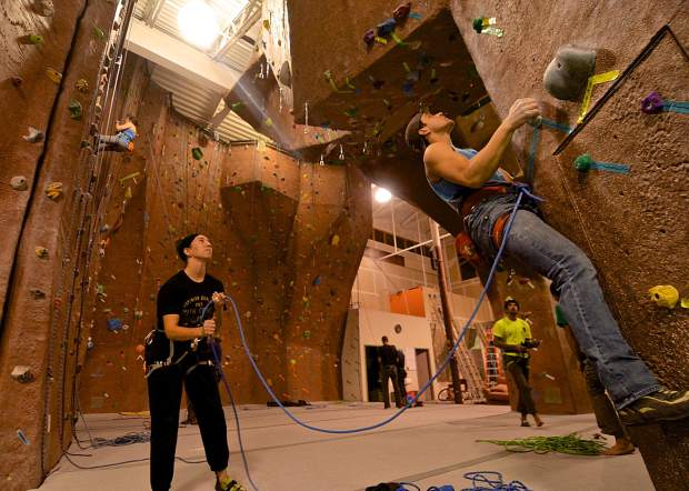 Laurin Smith (left) looks on as Eric Knapp begins a lead-climbing route on the overhang spire at Summit Climbing Gym in Silverthorne. The nonprofit, member-run gym is home to bouldering routes, lead climbing and top-roping on walls from 8 to 30-feet tall.