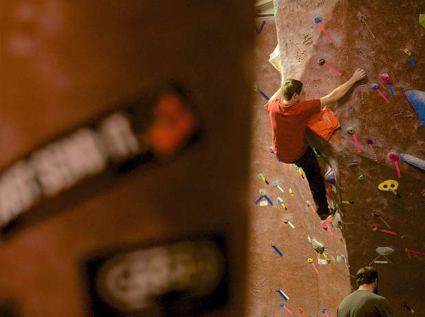 A member at Summit Climbing Gym works across the bouldering wall at the Silverthorne gym.