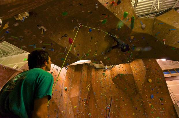 Longtime gym member Nathan Post (left) belays for his climbing partner, Steve Giles, as he works up the overhanging spire at Summit Climbing Gym in Silverthorne. The gym is operated almost complete by members, who volunteer to reset routes and keep the climbing area clean.