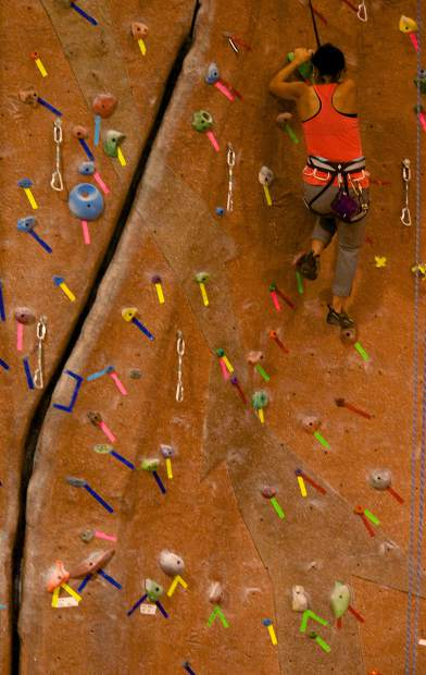 Claudia Hernandez picks through a line on the auto-bely wall at the Summit Climbing Gym in Silverthorne. The Silverthorne resident started climbing a year ago and now visits the gym three to four times per week during the winter months, when her favorite outdoor routes are frozen over.