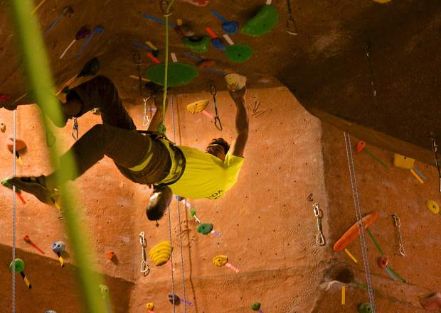 Nathan Petraitis eyes his next move on the overhanging spire at Summit Climbing Gym in Silverthorne. Petraitis has been a member for nearly three years at the nonprofit gym, which relies on members to volunteer for resetting routes and cleaning equipment.