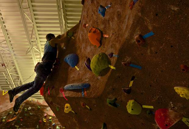 Eric Knoff finally reaches the top of a newly reset V6 bouldering route at the Summit Climbing Gym in Silverthorne. Members volunteer to set new routes every two or three weeks, keeping the problems fresh for climbers throughout the year.