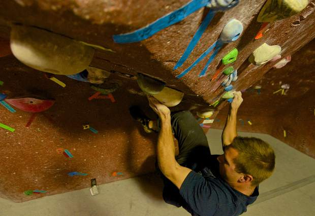 Seth Dobson of Dillon hangs from holds on the bouldering wall at Summit Climbing Gym in Silverthorne. The bouldering routes range from V0 to V7 or V8 and are reset every few weeks.