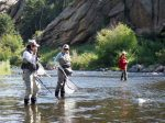 Fly-fishing guide Kristin Dougherty (middle) during a recent women's angling clinic. Doughtery regularly leads mother-daughter and other clinics through Anglers Covey, a fly-fishing shop in Colorado Springs.
