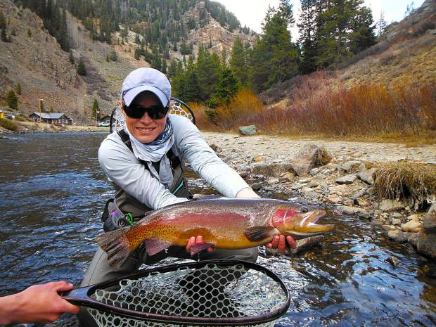 Fly-fishing guide Kristin Dougherty with a trout she caught earlier this summer. The Colorado Springs resident comes to Summit on Oct. 20 for a presentation at the monthly meeting for Gore Range Anglers, the local chapter of Trout Unlimited. The free meeting begins at 6 p.m. and is open to the public.