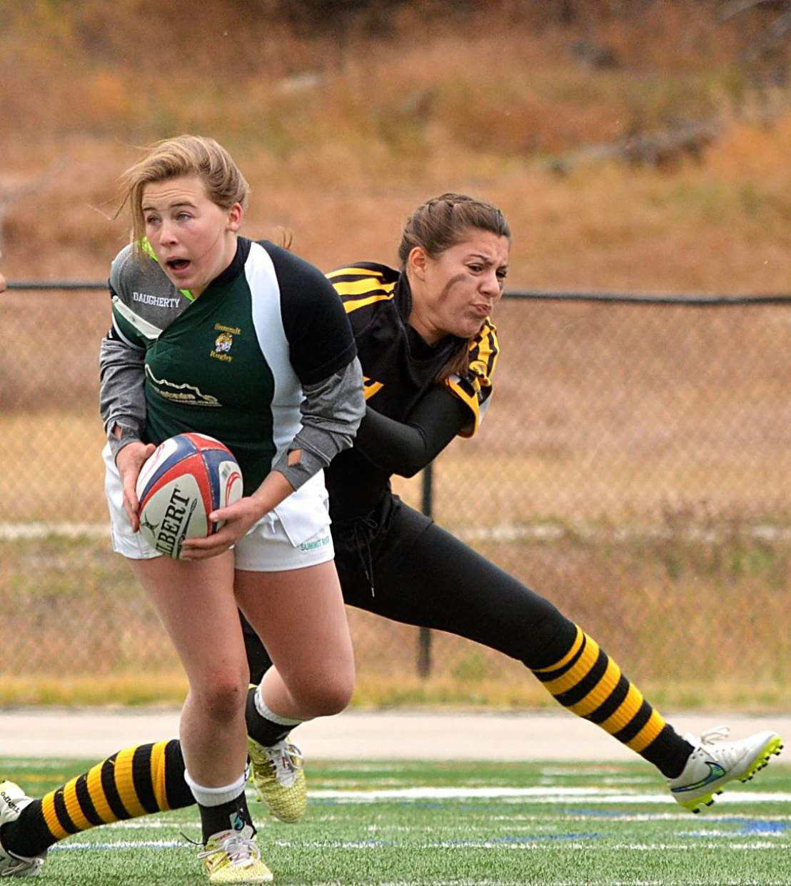 A player on the Summit Rugby green team looks for a pass during a game against Fort Collins at the rugby sevens tournament at Tigers Field on Sept. 24. Like their football counterparts, all rugby players are held to strict concussion protocol despite different equipment and styles of play.