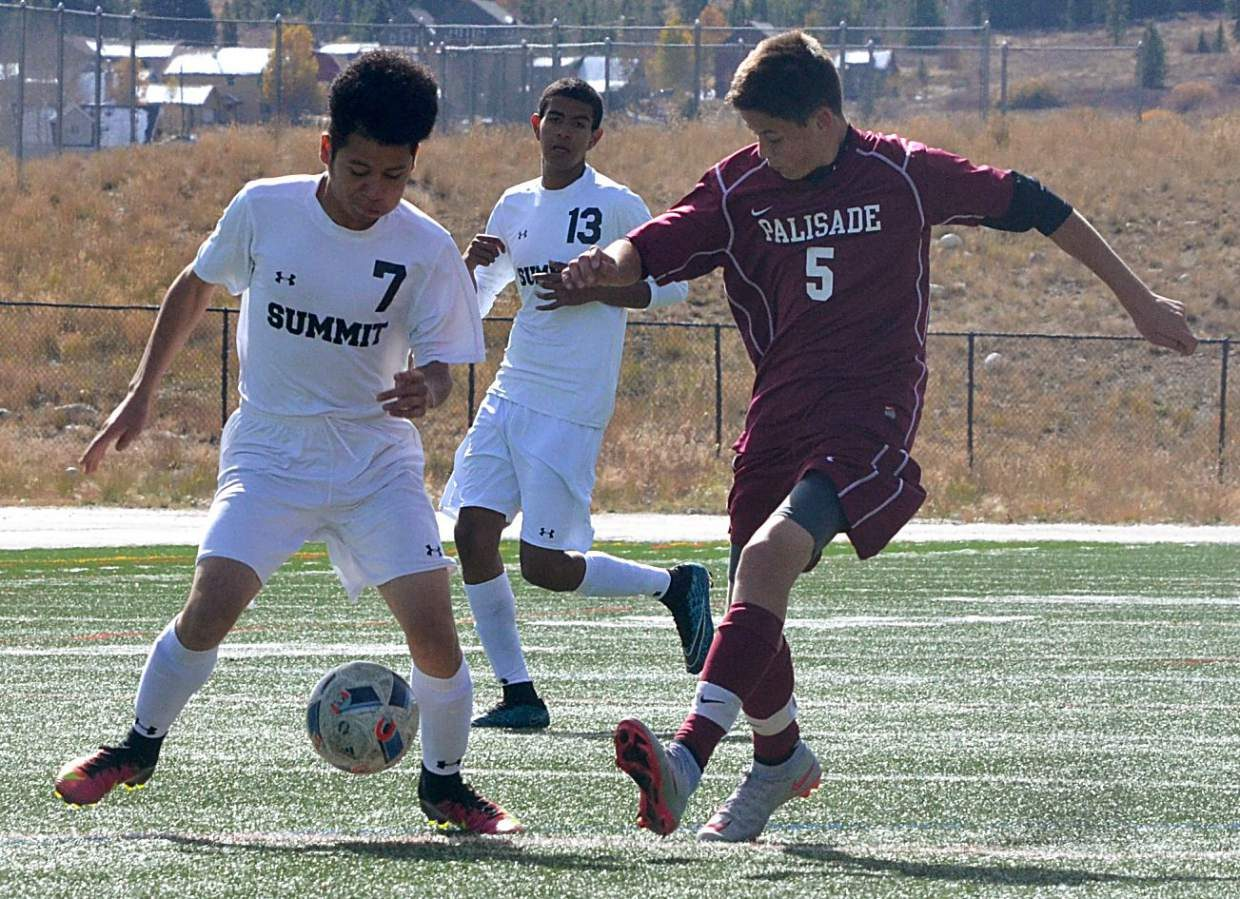 Summit forward Gerson Martinez (No. 7) takes the ball from a Palisade defender as mid Carlos Martinez (No. 13) looks on during a home varsity soccer game on Oct. 8. The Tigers won, 4-0.