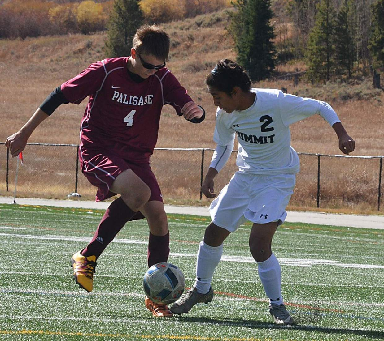 Summit's Farid Infante battles a Palisade defender for the ball during a home varsity soccer match on Oct. 8. The Tigers won, 4-0.