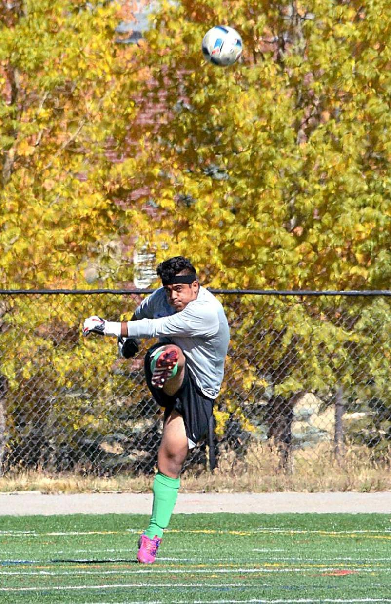Summit senior keeper Carlos Velasquez boots the ball downfield during a home varsity soccer game against Palisade on Oct. 8. The Tigers won, 4-0.