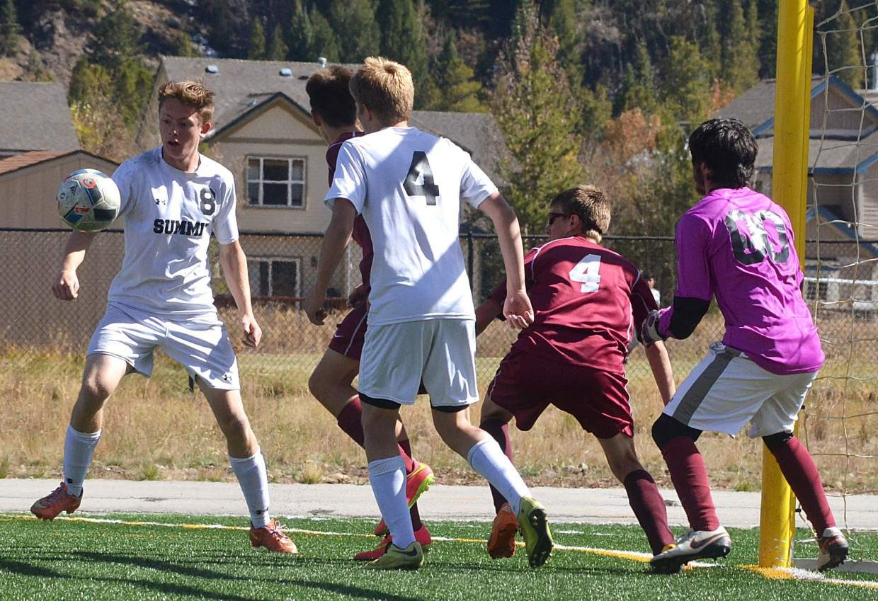 Summit's Conor Craig (N. 8) wrangles the ball as Palisade defenders collapse on the box during a home varsity soccer game on Oct. 8. The Tigers won, 4-0.