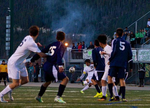 Summit senior Isaias Cortez (No. 20) takes a free kick into traffic during the Senior Night game against Rifle on Oct. 20. The Tigers won, 7-1, with seniors scoring all goals.
